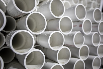 ends of a large stack of white pipes
